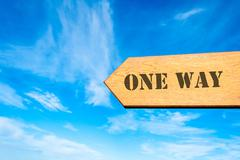 Directional wooden arrow with message ONE WAY Stock Photos