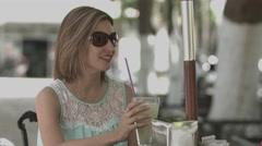 Female friends sitting in restaurant Stock Footage