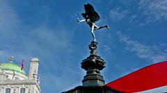 London. United Kingdom. Eros statue and buses in Piccadilly Circus Stock Footage