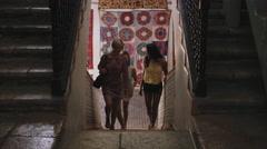 Women walking on steps Stock Footage