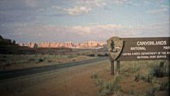 1971: Entering Canyonlands National Park with spectacular rock formations. Stock Footage