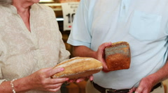 Senior couple shopping in grocery store Stock Footage
