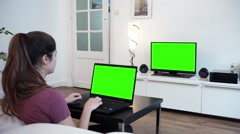 Girl With Green Screen Television And Computer - Full HD Stock Footage