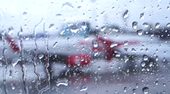 Raindrops on the air plane window with blur airport outside HD - stock footage