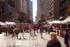 Time lapse of crowds Eighth Avenue Fall Festival, a New York City street market Stock Footage