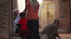 Uyghur muslims in alleyway, Kashgar Old Town Stock Footage