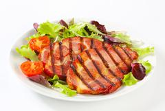 Grilled pork neck meat with salad greens Stock Photos