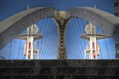Abstract bridge over docks at Salford Quays, Manchester - stock photo