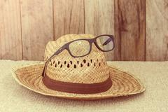 Wicker hat with eye glasses - stock photo