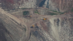 Trucks driving in mining pit transporting coal Stock Footage