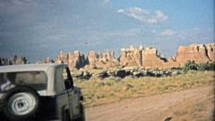 1971: Jeep driving to across the unique barren landscape. Stock Footage