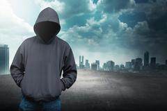 Faceless man in hood on the rooftop Stock Photos