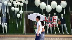 Shopper walking past a fashion window shop Stock Footage