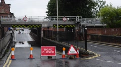First hull train crossing flooded and closed road selby uk Stock Footage