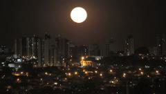 Super Moon - Real Scene Big Moon rising behind the buildings Stock Footage