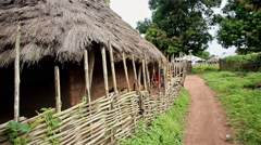 Daily life, Africa, Travel shot of village pathway Guinea Bisseau Stock Footage