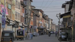 Pedestrian and motorcycle in street in old city,Srinagar,Kashmir,India - stock footage