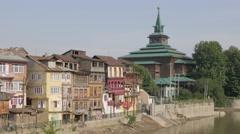 Old houses and Khanqah Shah-i-Hamadan at Jhelum river,Srinagar,Kashmir,India Stock Footage