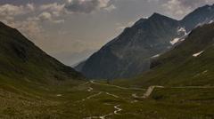 Fluelapass mountain road summer glacial valley  time lapse Davos Stock Footage