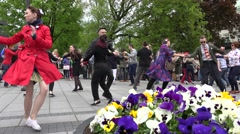 Dancers enjoy active lindy hop dance in pairs. 4K Stock Footage