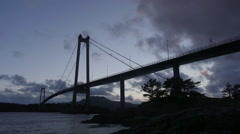Suspension bridge Norway silhouette evening view Stock Footage