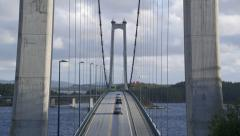 Suspension bridge Norway cars passing overhead view Stock Footage