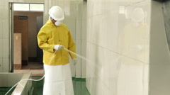 Worker cleaning up with pressurized water Stock Footage