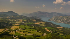 Ubaye valley rolling landscape and lake Alpes de Haute Provence time lapse 4K Stock Footage