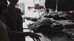 Female friends shopping in fish market Stock Footage