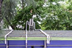 Air compressor on the roof with pipeline. Stock Photos