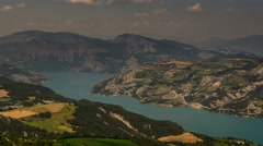 Ubaye lake and rolling hills Alpes de Haute Provence summer 4K Stock Footage