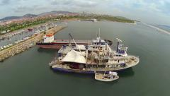 Flying over fisher boats berthed in front of the marina Stock Footage