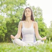 Yoga Meditating Relax Young Woman Outdoor. Healthy Lifestyle at beautiful sum - stock photo