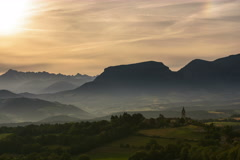 Hilltop village and church in Ecrins National park Alpes de Haute provence dawn - stock footage