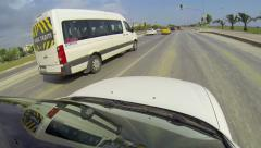 Car driving on a multi lane street at high speeds, overtaking other cars Stock Footage
