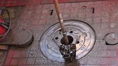 Drilling ahead - drill pipe rotated with slip on the rig floor Stock Footage
