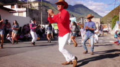 Dancing group on the streets of Banos during 100th anniversary of Sagrado Stock Footage