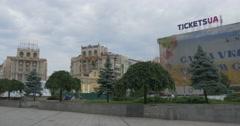 People Walking Maidan Nezalezhnosti With Its Impressive Monument to Archangel Stock Footage
