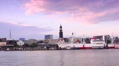 ULTRA HD 4K real time shot,Ships at Hamburg St. Pauli harbor at sunset Stock Footage