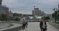 Pedestrians Moving Along Maidan Nezalezhnosti With Its Impressive Fountain and Stock Footage