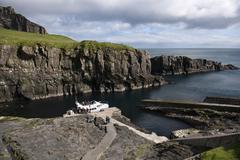 Boat arrival on Mykines, Faroe Islands - stock photo