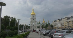 The Dolly Out Shot of the Bell Tower of St.sophia Cathedral and a Lot of People Stock Footage