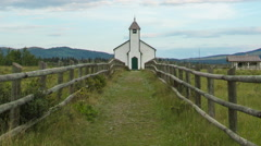 Zoom out on white rural church, time lapse Stock Footage