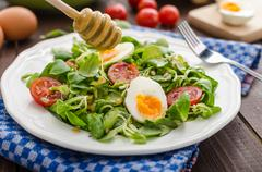 Lambs lettuce salad, hard-boiled eggs - stock photo