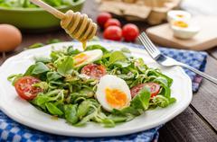 Lambs lettuce salad, hard-boiled eggs Stock Photos