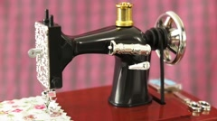 close up shot of antique Sewing machine model in action with dreamy effect - stock footage