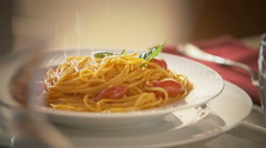 Spaghetti with tomato sauce, parmesan cheese falling in slow motion Stock Footage
