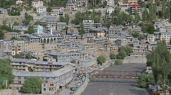 View over city with Suru river and bridge,Kargil,Ladakh,India Stock Footage