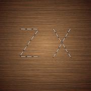 Vector modern staples alphabet on wooden - stock illustration