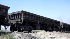Steam train transporting coal, driving on the track Stock Footage